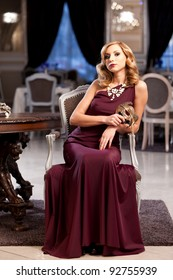 Beautiful blond with a mask in an elegant red dress. Please see more images from the same shoot.