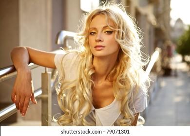 Beautiful blond model outdoor. Street fashion photo.