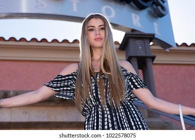 Beautiful blond model shopping.