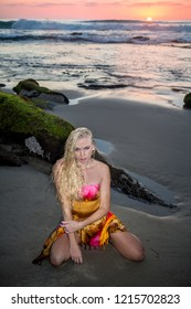 beautiful blond on the beach at sunset
