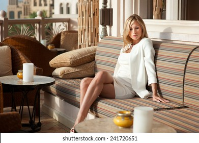 Beautiful blond russian professional model girl having joy and relax in luxury spa resort in tropical country with blue sky background