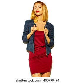 beautiful blond sexy hot woman girl in red dress and jacket isolated on white making duck face