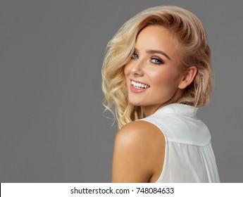 Beautiful blond smiling woman