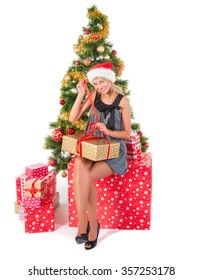 Beautiful blond smiling woman and the Christmas tree.