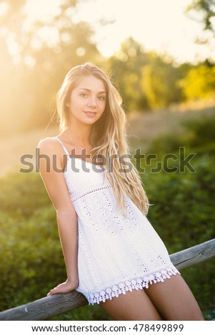Beautiful Blond Teenager Portrait Outdoors In The Park Filtered Image With Flare