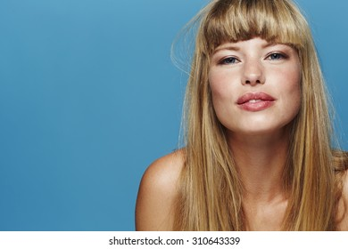 beautiful blond woman against blue background