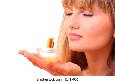 beautiful blond woman applying perfume on her body over white