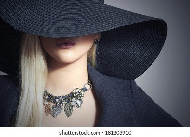 Beautiful Blond Woman in Black Hat. Close-up. Elegance Beauty Girl.Spring Shopping. Accessories. Lady in Jewelry