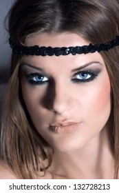 Beautiful blond woman with a black headband and attractive makeup