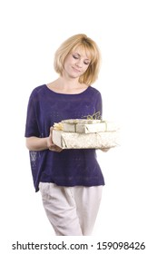 beautiful blond woman in a blue blouse with Christmas gifts in their hands, in the studio on a white background