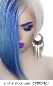 beautiful blond woman with blue hair.Girl with colored hair and make-up