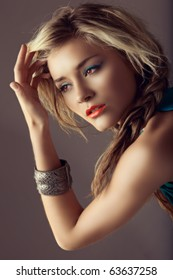 beautiful blond woman with braided hair and coral lipstick in retro cross-process effect