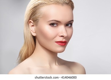 Beautiful blond woman with bright make-up. Sexy look with clean skin and red lips makeup. Laughing girl with perfect beautiful smile. Whitening teeth