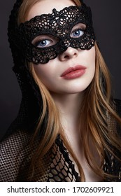 Beautiful Blond Woman in a Carnival Mask. Masquerade. Sexy Girl in mask. Beauty & Fashion