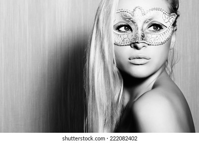 Beautiful Blond Woman in a Carnival Mask.Masquerade. Sexy Girl. art monochrome portrait.texture background