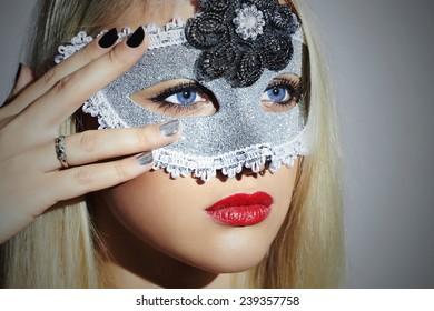 Beautiful Blond Woman in Carnival Mask.Masquerade. Sexy Girl with blue eyes. Lovely.Manicure Nail