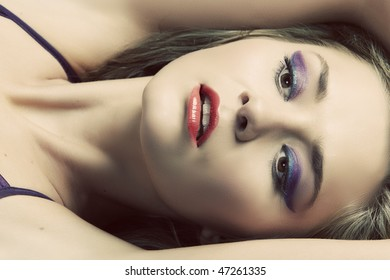 beautiful blond woman with cat eye make-up and coral lips