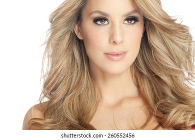 Beautiful blond woman closeup looking dreamy.