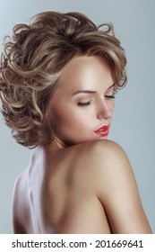 Beautiful blond woman with curly hairstyle. Vogue glamour photoshoot.