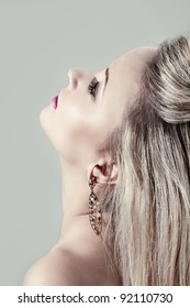 Beautiful blond woman with earrings