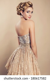 beautiful blond woman in elegant sequin dress