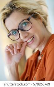 Beautiful blond woman with eyeglasses
