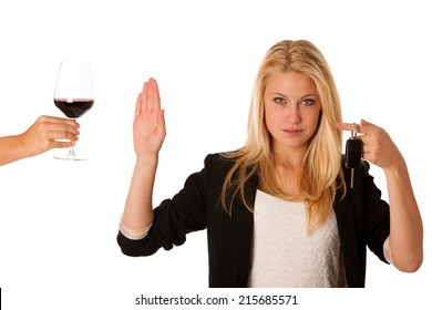 beautiful blond woman gesturing don't drink and drive gesture, with refusing a glass of red wine isolated over white