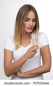 Beautiful blond woman with glass of water white background