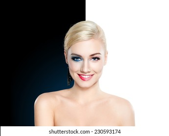 Beautiful blond woman half clean and half face with make up - glamour concept