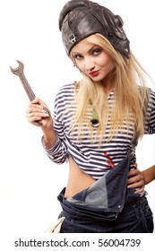 beautiful blond woman in jeans with wrench