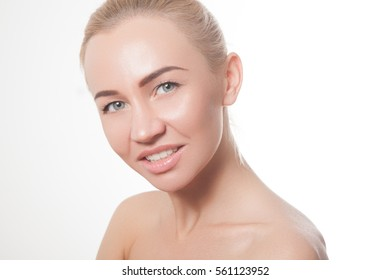 Beautiful blond woman with natural make-up.Clean skin of the face. Bright eyes. Snow-white smile. Pink lip gloss. Natural beauty.