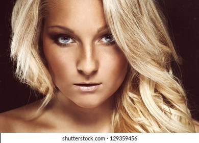 Beautiful blond woman on black