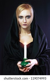 beautiful blond woman portrait with burning candle.