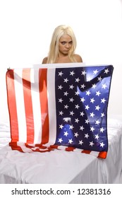 beautiful blond woman silouehetted against an american flag