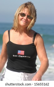 Beautiful Blond Woman walking on the Beach in San Clemente