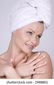beautiful blond woman wearing blue towel and natural makeup