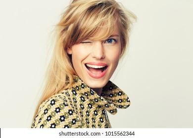 beautiful blond woman winking to camera, portrait