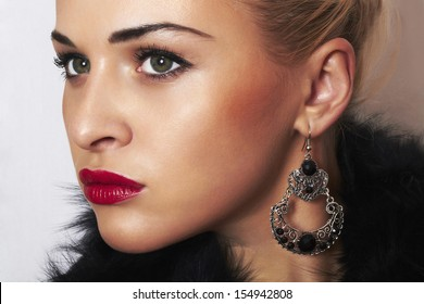 beautiful blond woman.Jewelry and Beauty. Fashion.red lips.girl.ornamentation