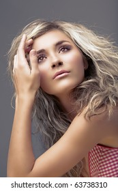 beautiful blond young woman with curly hair and natural make-up