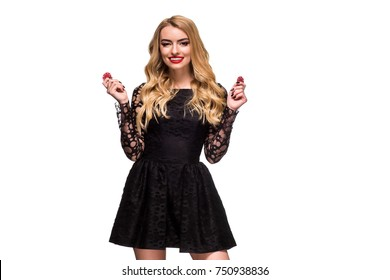 Beautiful blonde in a black dress with casino chips in hands isolated on a white background