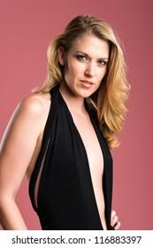 Beautiful blonde in a black sheath dress