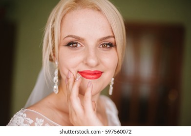 Beautiful blonde bride with beautiful makeup smiling. Portrait