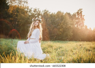 Beautiful blonde bride. Bride at sunset.