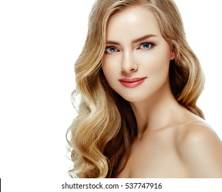 Beautiful blonde curly woman face close up studio on white