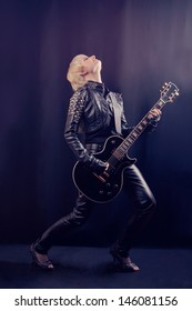Beautiful blonde with electric guitar