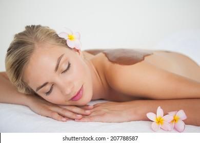 Beautiful blonde enjoying a chocolate beauty treatment at the health spa