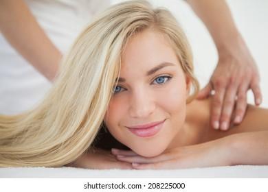 Beautiful blonde enjoying a massage at the health spa