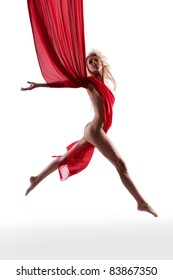 Beautiful blonde fashion model nude with red cloth