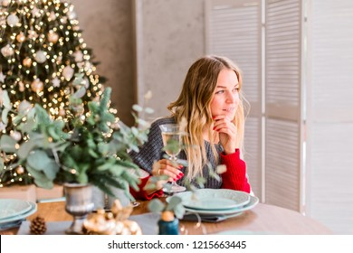 beautiful blonde at the festive Christmas table