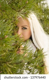 beautiful blonde girl of about tree in winter